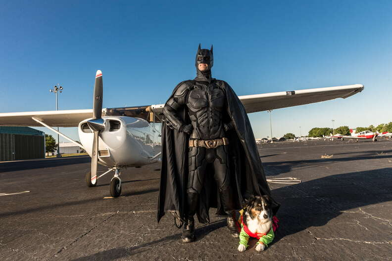 Batman and his dog, dressed as Robin