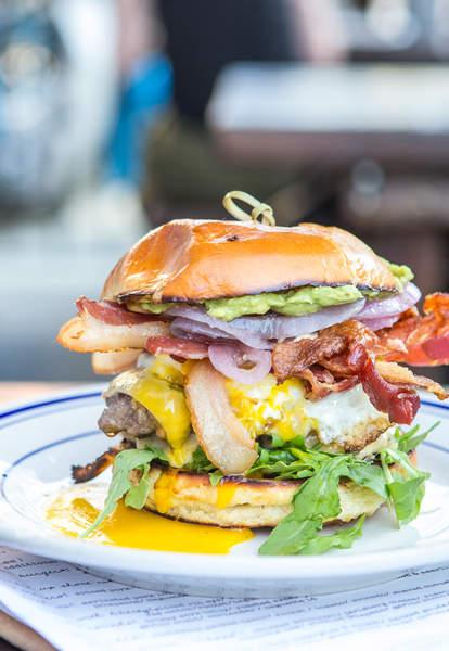 burger bacon cheese cheeseburger toppings pickles lettuce tomato guac avocado guacamole buns toasted egg yolk