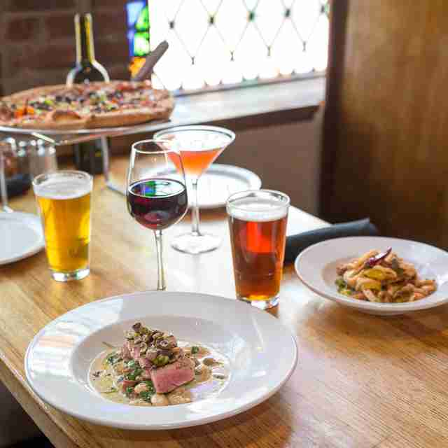 Cheap places to eat with alcohol near me
