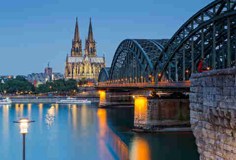 lighted Cologne Cathedral and Hohenzollern Bridge