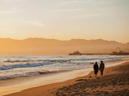 Couple walking at Santa Monica Beach