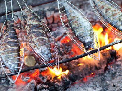 fish cooking over campfire