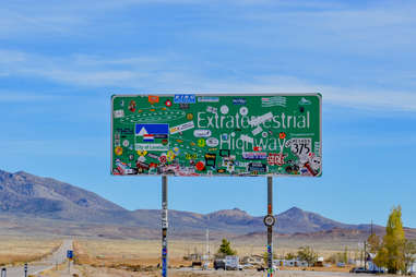 Extraterrestrial Highway sign with mountains in the distance