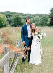 Deer photobombs Michigan couple's wedding photos