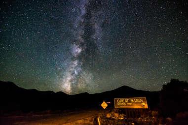 a road through a desert at night