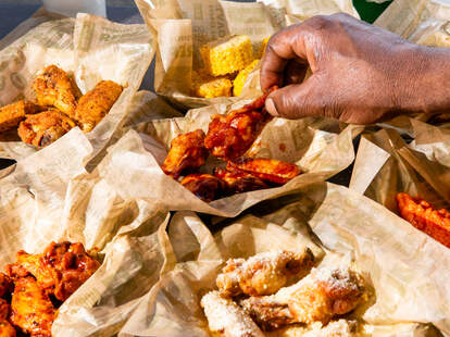 Wingstop wings with sauce and garlic parmesan chicken wing fast casual order fries