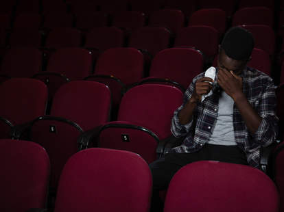 man crying at theater