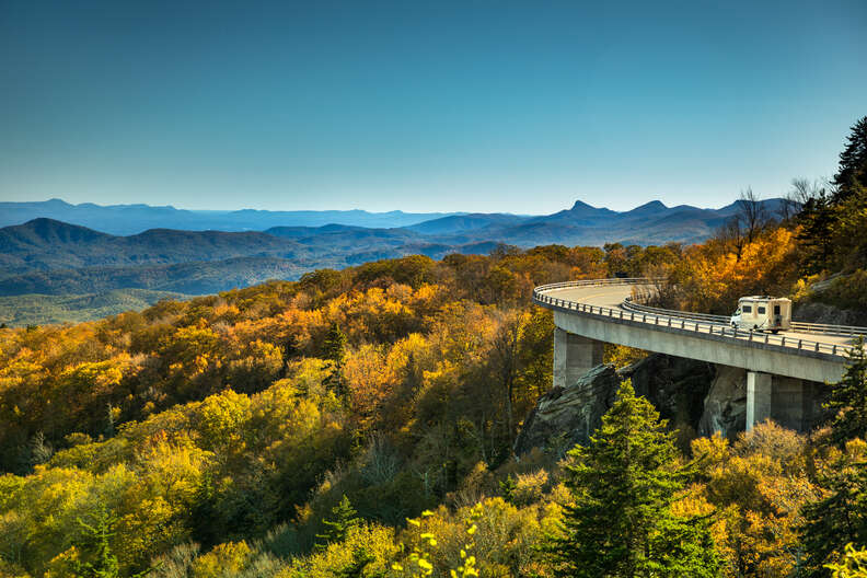 an rv rolling along a road through the blue ridge parkway