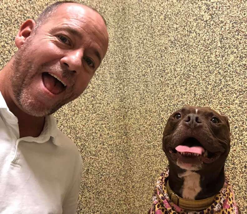 Selfie of man and smiling dog