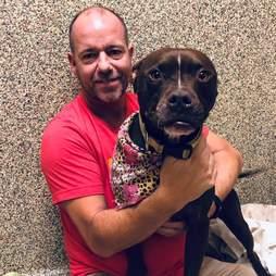 Man hugging shelter dog