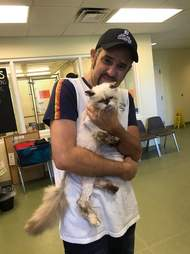 Man holding cat he lost three years ago