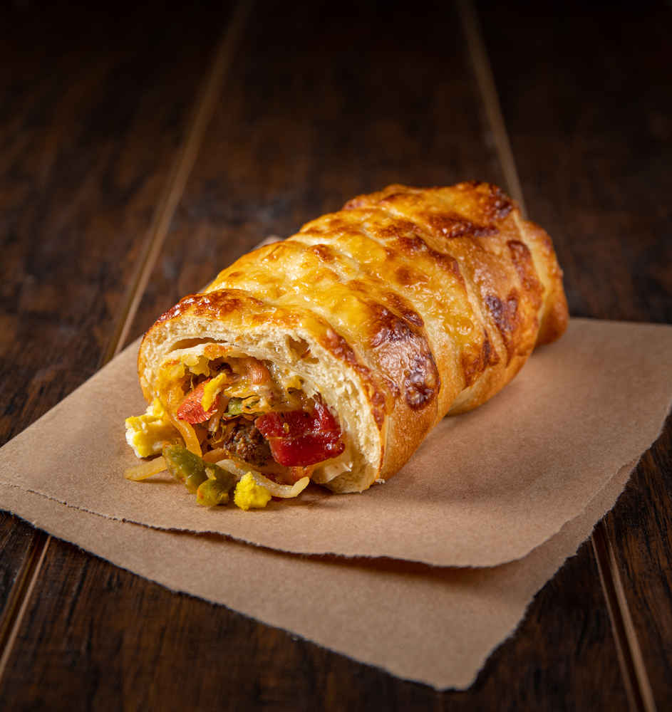 Einstein Bros.'s New Breakfast Burrito-Bagel Hybrid Is Stuffed With Meats and Cheese