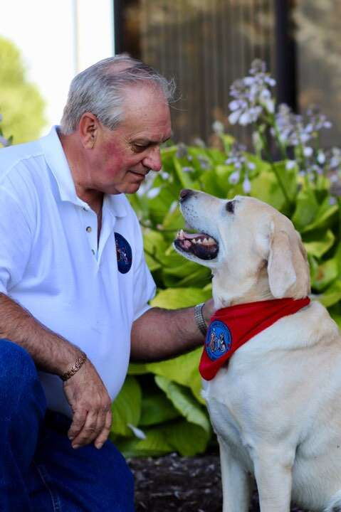 Benji the therapy dog and his dad