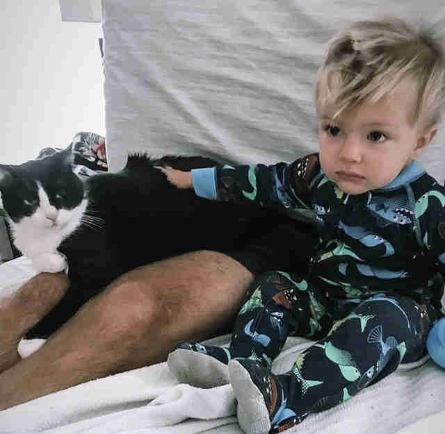 Little boy has conversations with cat