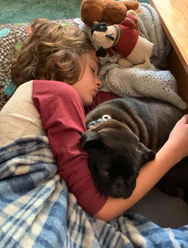 Carter Licata snuggles his dog Piper