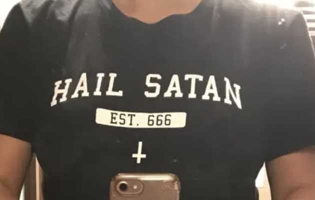 Passenger Asked to Get Off Plane When She Boarded Wearing a 'Hail Satan' Shirt
