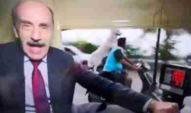 Dog on a motorbike photobombs journalist
