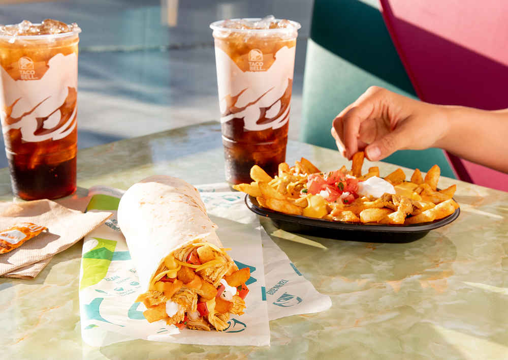 Taco Bell Has New Buffalo Chicken Nacho Fries & You Can Get Them in a Burrito