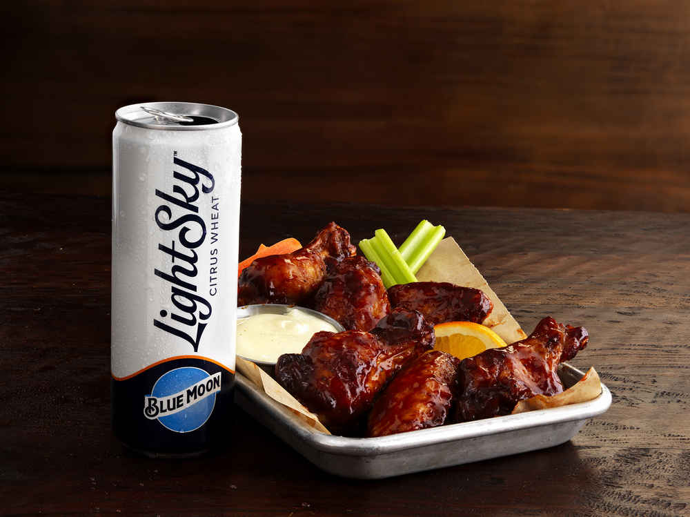 Buffalo Wild Wings Is Bringing Back Its BBQ Sauce Made With Blue Moon