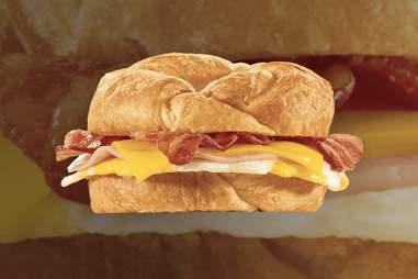 jack in the box fully loaded croissant sandwich eggs ham bacon cheese