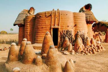 mud hut with woodoo altar