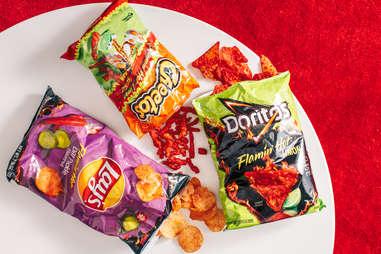 flamin' hot cheetos doritos and lays spicy chips snacks
