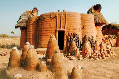 A traditional mud hut on the savanna
