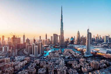 a view of the 2,722 foot tall Burj Khalifa building at sunrise in Dubai, UAE
