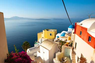 a view overlooking the ocean from the cliffs of Santorini, Oia, Greece