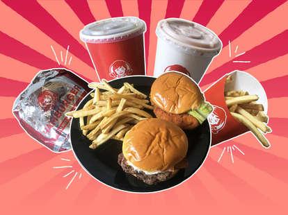 A Wendy's spicy chicken sandwich, Baconator, fries, Coke Zero. and Frosty
