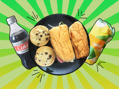 Diet coke, two chocolate chop cookies, and two Subway sandwiches