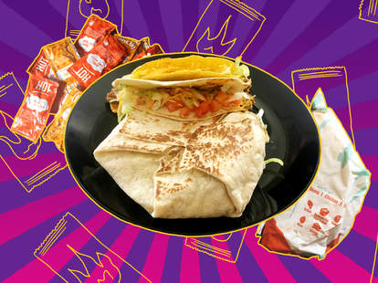 Taco Bell hot and mild sauce packets, a crunchy taco, soft taco supreme, and a Crunchwrap Supreme