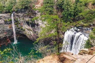 several waterfalls streaming into a lake