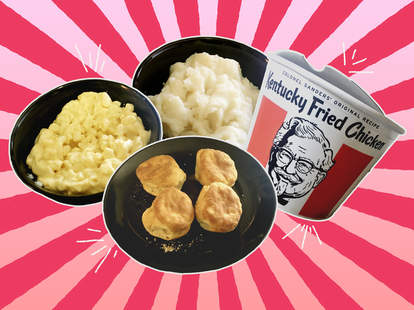 KFC mac and cheese, mashed potatoes, bucket of chicken, and biscuits