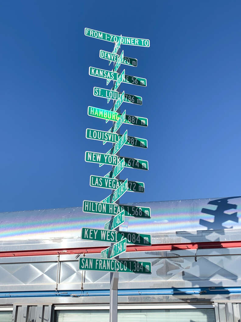 green signs outside i-70 diner