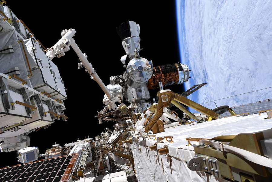 NASA Astronauts Snap Photo of SpaceX Crew Dragon Spacecraft During Spacewalk
