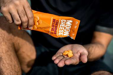 bags of moon cheese cheddar flavor you chedda believe it snacking keto