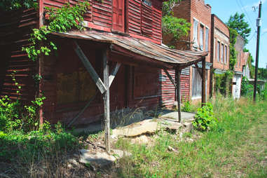 abandoned, overgrown storefronts
