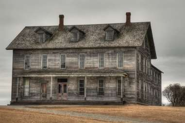 a creepy abandoned wooden mansion