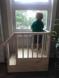Dad builds a fort so his son can look out the window