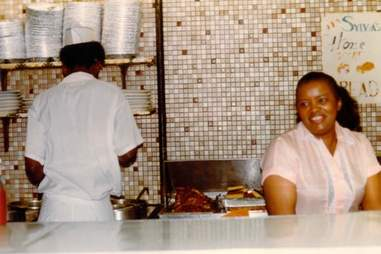 "Sylvia Woods ""The Queen of Soul Food"" behind the luncheonette counter"
