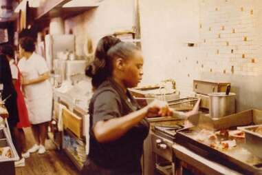 """Sylvia Woods """"The Queen of Soul Food"""" behind the luncheonette counter"""