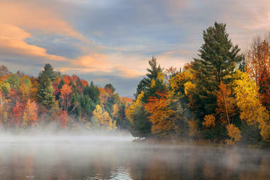 Stowe, Vermont fall foliage beside fog and water