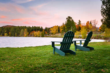 Lake Placid, New York waterfront with chairs during the fall