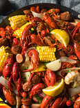 seafood boil weekend project crawfish boils thrillist spicy corn shrimp lemon butter cajun sea food potato recipe recipes clams mussels seasoning
