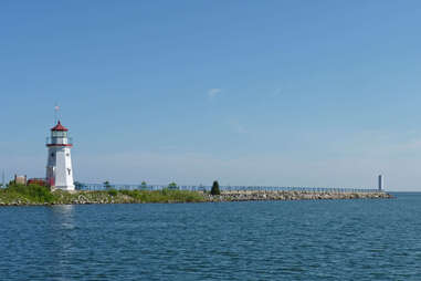a lighthouse on a lakeshore