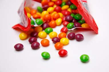 skittles spilling out of bag