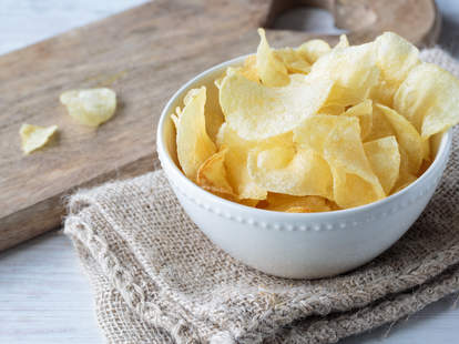Crispy potato chips in a bowl