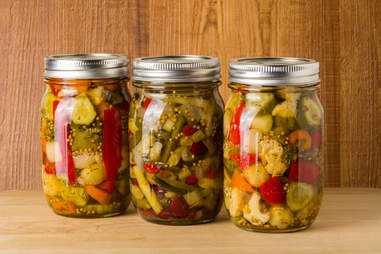 canned vegetables in Mason jars