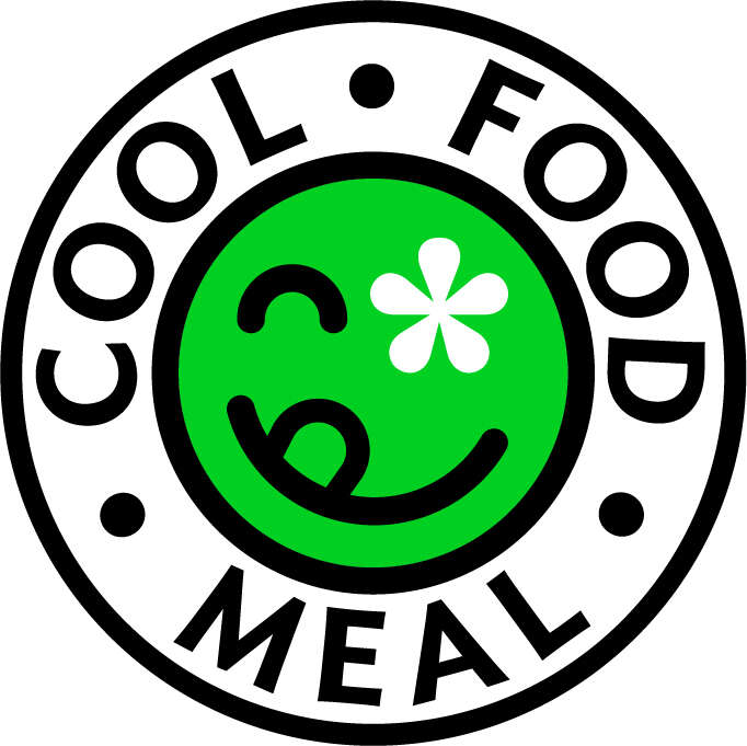 A green, winking smiley-face is Panera's eco-friendly food badge.